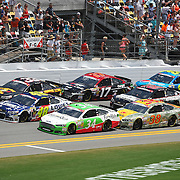 NASCAR Sprint Cup driver Jimmie Johnson (48)  leads the pack down the front stretch during the 56th Annual NASCAR Coke Zero 400 race at Daytona International Speedway on Sunday, July 6, 2014 in Daytona Beach, Florida.  (AP Photo/Alex Menendez)