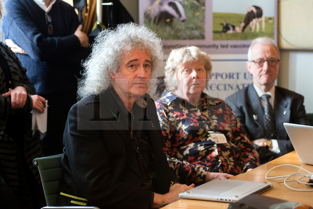 © Licensed to London News Pictures.04/02/2014. London, UK. Queen guitarist Brian May presents a speech during the launch of a badger and cattle vaccination initiative in Portcullis House, London. Together with cosmetics company Lush and animal welfare organisations he is launching a nationwide appeal to promote and support vaccination of badgers and cattle as a tool in the fight against bovine TB. Photo credit : Peter Kollanyi/LNP