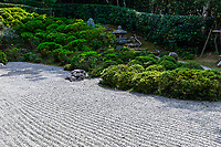 Konpuku-ji Garden consists of two parts, the lower temple and the Basho-an higher up the hill. The temple's zen garden is a classic rock garden with many satsuki rhododendrons, making early summer the best time to visit this temple. Near the entrance of the garden on the right lies a small tsukubai basin.  A small path goes around the back of the garden and climbs a slope covered with satsuki to reach Basho-an. Konpuku-ji was built in 864 by a priest named Jikaku but was later destroyed then rebuilt by another priest named Tesshu.  Around 1670, the famous poet Bashostopped at this temple for a few nights, and stayed in a small hut of the temple, which was later renamed Basho-an.