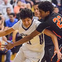 Miyamura Patriot Darin Baca (21) pushes past Gallup Bengal Nate Zakarri Fields (22) Thursday at Miyamura High School.