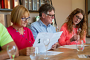 A man and two women read leaflets with information about the vineyard and wine making during a wine tasting session at Hush Heath Winery, Staplehurst, Kent, England, UK. (photo by Andrew Aitchison / In pictures via Getty Images)