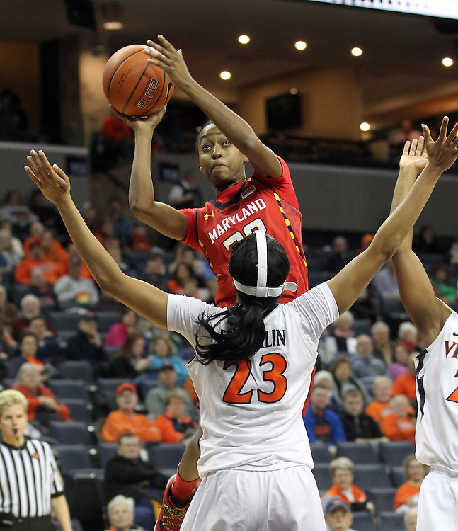 Maryland guard Shatori Walker-Kimbrough (32) shoots over Virginia guard Ataira Franklin (23) during the game Thursday in Charlottesville, VA. Photo/The Daily Progress/Andrew Shurtleff
