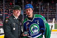 REGINA, SK - MAY 23: Glenn Gawdin #15 of the Swift Current Broncos receives a star of the game from Commanding Officer, Lieutenant Jay MacKeen - PPCLI 2nd Battilion at the Brandt Centre on May 23, 2018 in Regina, Canada. (Photo by Marissa Baecker/CHL Images)