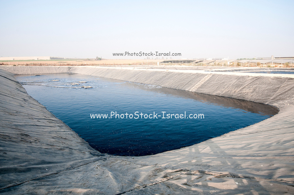 Sewerage treatment facility. The treated water is then used for irrigation and agricultural use. Photographed near Hadera, Israel. final stage the clear water is aerated and exposed to oxygen with floating diffuser units to allow biological activities