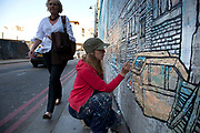 New work by street artist Jo Peel on Holywell Lane, Shoreditch. Jo Peel is a member of internationally acclaimed Scrawl Collective and spends her time documenting in great detail her fascination with everyday scenes and scenarios.  Street art in the East End of London is an ever changing visual enigma, as the artworks constantly change, as councils clean some walls or new works go up in place of others. While some consider this vandalism or graffiti, these artworks are very popular among local people and visitors alike, as a sense of poignancy remains in the work, many of which have subtle messages.
