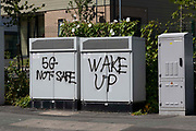 Graffiti on comms boxes that reads 5G Not Safe and Wake Up, referencing conspiracy theories related to the spread of Coronavirus on 1st July, 2021 in Batley, United Kingdom. Throughout the Covid-19 pandemic, fake news has been spread online suggesting that 5G networks in the UK have been responsible for transmitting the virus.