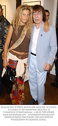 Musician BILL WYMAN and his wife SUZANNE, at a party in London on 4th September 2002.	PCU 16