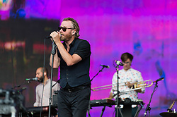 © Licensed to London News Pictures. 12/07/2014. London, UK.   The National performing live at Hyde Park as part of the British Summer Time series of outdoor concerts.  In this picture - Matt Berninger. The National is an American indie rock band consisting of members Matt Berninger (lead vocals), Aaron Dessner (guitar, bass, piano, keyboards), Bryce Dessner (guitar, keyboards), Bryan Devendorf (drums), Scott Devendorf (bass, guitar, backing vocals).  Photo credit : Richard Isaac/LNP