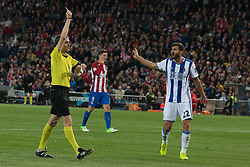 April 4, 2017 - Madrid, Spain - Yellow card for Rulli (Real Sociedad goalkeeper) Raul Navas (R) protest during the match between Atletico de Madrid and Real Sociedad. At.Madrid won over Real Sociedad with 1-0. (Credit Image: © Jorge Gonzalez Moreno/Pacific Press via ZUMA Wire)