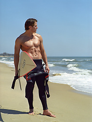 sexy surfer at the ocean