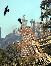 Sep 16, 2002; New York, NY, USA; The wreckage of the South Tower of the World Trade Center lies still and smoldering after it was hit by two passenger jets Sept. 11. .  (Credit Image: Toronto Star/ZUMAPRESS.com)