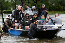 August 29, 2017 - Houston, Texas, U.S. - Volunteer rescue workers use a boat to take stranded residents from Kelliwood subdivision in Houston, to higher ground, on Tuesday. (Credit Image: © San Antonio Express-News via ZUMA Wire)
