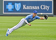 Kansas City Royals second baseman Whit Merrifield (15) makes a diving attempt for the ball during the seventh inning against the Cincinnati Reds at Kauffman Stadium.