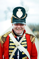 11 January 2015. New Orleans, Louisiana. <br /> Bicentennial reenactment of the Battle of New Orleans in Chalmette. <br /> John Truelove of the Royal Welsh Fuseliers  of the British forces prepares to re-enact the January 8th, 1815 disastrous battle against American foes marking the 200th anniversary of the Battle of New Orleans in Chalmette. Despite heavily outnumbering the Americans, the British suffered over 2,000 casualties, with many senior officers amongst the dead and injured compared to the Americans who suffered a mere 70 by comparison. The American victory was hailed as miracle.<br /> Photo; Charlie Varley/varleypix.com