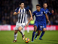 """Everton's Dominic Calvert-Lewin (right) and West Bromwich Albion's Gareth Barry battle for the ball during the Premier League match at The Hawthorns, West Bromwich. PRESS ASSOCIATION Photo. Picture date: Tuesday December 26, 2017. See PA story SOCCER West Brom. Photo credit should read: Nick Potts/PA Wire. RESTRICTIONS: EDITORIAL USE ONLY No use with unauthorised audio, video, data, fixture lists, club/league logos or """"live"""" services. Online in-match use limited to 75 images, no video emulation. No use in betting, games or single club/league/player publications."""