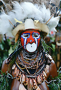 Tribesman in war paint and feathered headdress during  a tribal gathering at Mount Hagen in Papua New Guinea