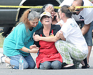 Robin Zielinski/Sun-News<br /> The mother of a man fatally shot by Las Cruces police cries on the corner of Branding Iron Circle and Bronco Way Tuesday afternoon.