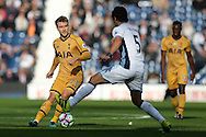 Christian Eriksen of Tottenham Hotspur goes past Claudio Yacob of West Brom.  Premier league match, West Bromwich Albion v Tottenham Hotspur at the Hawthorns stadium in West Bromwich, Midlands on Saturday 15th October 2016. pic by Andrew Orchard, Andrew Orchard sports photography.