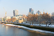 The Tower of London and City skyscrapers are dusted with snow in London, England on February 28th, 2018. Freezing weather conditions dubbed the Beast from the East have brought snow and sub-zero temperatures to the UK.