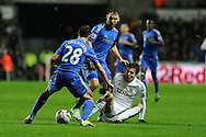 Swansea city's Michu is crowded out by Chelsea's Cesar Azpilicueta (28) and Branislav Ivanovic. Capital one cup semi final, 2nd leg, Swansea city v Chelsea at the Liberty Stadium in Swansea on Wednesday 23rd Jan 2013. pic by Andrew Orchard, Andrew Orchard sports photography,