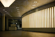 Interior of a new office building with dramatic lighting along one wall.