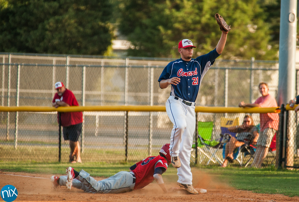 Concord Post 51's Parker Henderson reaches out to catch the ball as Rowan County's Jeremy Simpson Tuesday night at Central Cabarrus High School. Concord won the game 7-6 in the second game of a best-of-five game playoff series.
