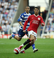 Photo: Chris Ratcliffe.<br />Reading v Manchester United. The Barclays Premiership. 23/09/2006.<br />Cristiano Ronaldo of Manchester United clashes with James Harper of Reading.