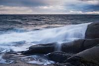 Waves crash over rocky coastline, Stamsund, Vestvågøya, Lofoten Islands, Norway
