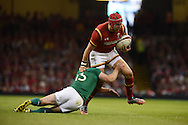 Tyler Morgan of Wales is tackled by Ireland's Keith Earls.Wales v Ireland rugby union international, RWC warm up friendly match at the Millennium Stadium in Cardiff, South Wales on Saturday 8th August  2015.<br /> pic by Andrew Orchard, Andrew Orchard sports photography.