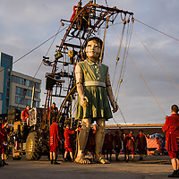 LIVERPOOL, UK, 20th April, 2012. The Sea Odyssey. The little girl giant. A massive puppet by Royal de Luxe as part of the Sea Odyssey event.