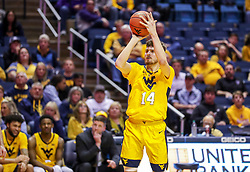 Feb 18, 2019; Morgantown, WV, USA; West Virginia Mountaineers guard Chase Harler (14) shoots a three pointer during the second half against the Kansas State Wildcats at WVU Coliseum. Mandatory Credit: Ben Queen-USA TODAY Sports