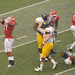 Dec 5, 2009; Piscataway, NJ, USA; Rutgers linebacker Damaso Munoz (17) celebrates a third-down stop during first half NCAA Big East college football action between Rutgers and West Virginia at Rutgers Stadium.