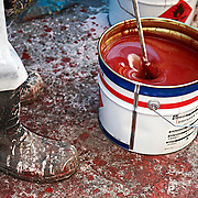 paint being mixed for spray painting ships