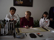 BEIJING, CHINA - OCTOBER 29: (CHINA OUT) <br /> <br /> German Chancellor Angela Merkel Visits China<br /> <br /> Angela Merkel, German politician and former research scientist who has been the Chancellor of Germany, signs her name on a scroll during her visiting the Former Residence of Soong Ching Ling to attend the 16th Bergedorf Round Table on October 29, 2015 in Beijing, China. German Chancellor Angela Merkel has started her eighth visit to China on Thursday and talked worldwide questions with Chinese leaders. <br /> ©Exclusivepix Media