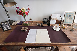 "© Licensed to London News Pictures. 13/11/2018. LONDON, UK. Personal items in Ruth Ellis' prison cell.  Preview of ""Glad I Did It"", a new work by Irish artist Christina Reihill at Bermondsey Project Space.  The interactive artwork looks at the life and death of Ruth Ellis, the last woman to be hanged in Britain, after she shot her lover, racing driver, David Blakely in 1955.  On display are the artist's interpretation of Ruth Ellis' prison cell, including furniture and props, the hanging room together with a video display of the artist in conversation.   The show runs 14 November to 1 December 2018.  Photo credit: Stephen Chung/LNP"