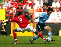 Photo. Chris Ratcliffe<br />Charlton v Man City. FA Premiership. 17/05/2003<br />Sun Jihai and Jason Euell challenge for the ball