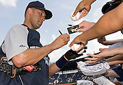 ATLANTA - JUNE 25:  Shortstop Derek Jeter #2 of the New York Yankees signs autographs for fans before the game against the Atlanta Braves at Turner Field on June 25, 2009 in Atlanta, Georgia.  The Yankees beat the Braves 11-7.  (Photo by Mike Zarrilli/Getty Images)