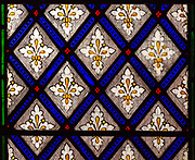 Stained glass windows c 1850 James Powell and Sons ornamental floral fleur de lis pattern, Beechingstoke church, Wiltshire, England, UK
