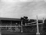 """05/08/1960<br /> 05/08/1960<br /> 05 August 1960<br /> R.D.S Horse Show Dublin (Friday). Aga Khan Trophy. Lieut-Col. Carlos Delia (Argentina) on """"Huipil"""", clears the stone wall on his 2nd round, to give Argentina victory in the Aga Khan Jumping Competition at the Dublin Horse Show."""