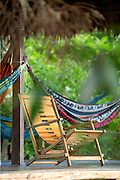 Deck chair and hammock on decking in Manu learning centre, Manu National Park, Peru, South America