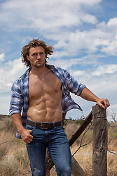 hot muscular man with open shirt outdoors