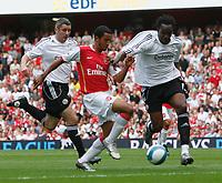 Photo: Steve Bond.<br />Arsenal v Derby County. The FA Barclays Premiership. 22/09/2007. Claude Davis (R) closes down Theo Walcott (C).  Andy Griffin follows