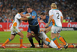 PRETORIA, South Africa, 28 May 2011. Dean Greyling of the Bulls powering forward with Sias Ebersohn of the Cheetahs making the tackle during the Super15 Rugby match between the Bulls and the Cheetahs at Loftus Versfeld in Pretoria, South Africa on 28 May 2011..Photographer : Anton de Villiers / SPORTZPICS