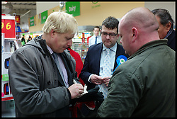London Mayor Boris Johnson Campaigning in Feltham, West London, for the By-Election with Mark Bowen the Conservative Party Candidate, Tuesday December 13, 2011 Photo By Andrew Parsons/ i-Images