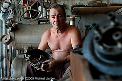 Sobrino in his home shop. Havana, Cuba 2009<br /> <br /> Limited Edition Print from an edition of 30. Photo ©2009 Michael Lichter.