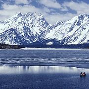 Canoeists on Jackson Lake in Grand Teton National Park, Wyoming.