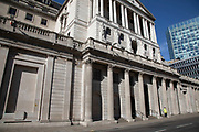 Bank of England in the City of London financial district is virtually deserted due to the Coronavirus outbreak on 23rd March 2020 in London, England, United Kingdom. Following government advice city workers are staying at home to work leaving the streets quiet, empty and eerie. Coronavirus or Covid-19 is a new respiratory illness that has not previously been seen in humans. While much or Europe has been placed into lockdown, the UK government has announced more stringent rules as part of their long term strategy, and in particular social distancing.