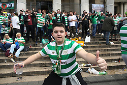 27 September 2017 Brussels: Celtic fans in the city centre before the Champions League match against Anderlecht: the steps of the Stock Exchange (La Bourse) are full of  supporters: Photo: Mark Leech