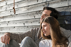 Couple man woman relaxing wooden wall