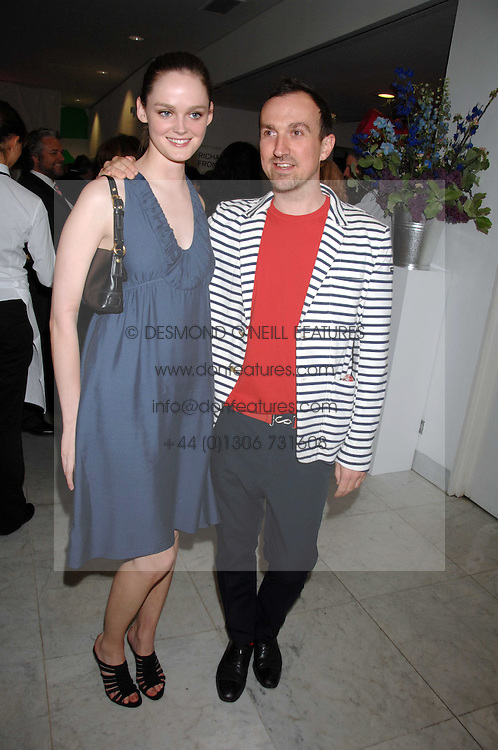 LISA KENT and photographer TIM WALKER at a reception hosted by Vogue magazine to launch photographer Tim Walker's book 'Pictures' sponsored by Nude, held at The Design Museum, Shad Thames, London SE1 on 8th May 2008.<br /><br />NON EXCLUSIVE - WORLD RIGHTS